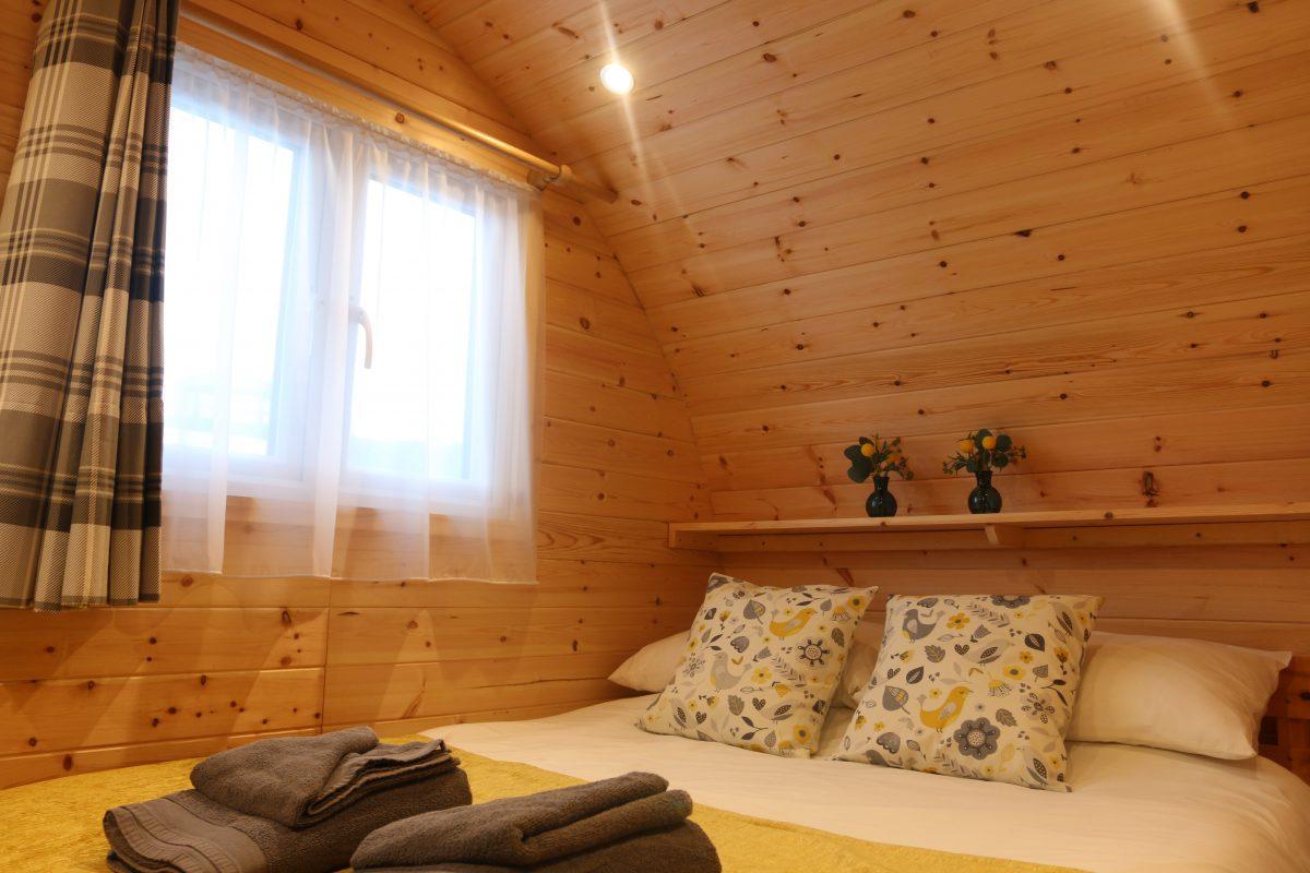 Wooden Glamping Pod Master Bedroom